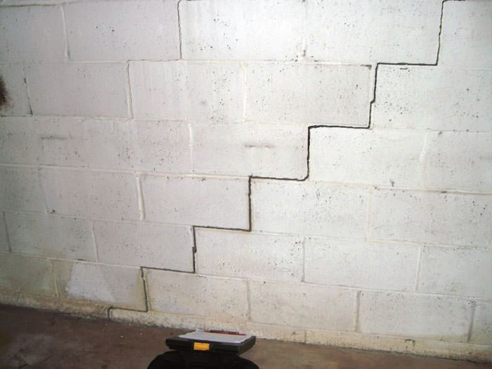 A Diagonal Stair Step Along The Foundation Wall Of Hammond Home