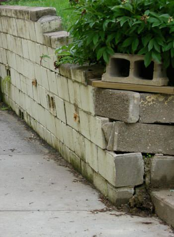 collapsing retaining wall with severe damage in Chesterton