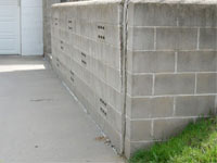 A retaining wall separating from the adjoining walls in Rochester