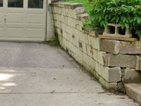 a failing retaining wall around a driveway in Fort Wayne