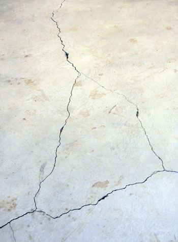 severely cracked, heaving slab floors in a home in Schererville