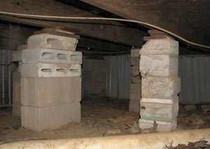 crawl space repairs done with concrete cinder blocks and wood shims in a Hammond home