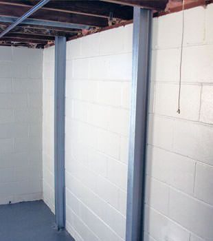 A PowerBrace™ i-beam foundation wall repair system in Fort Wayne