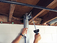 Straightening a foundation wall with the PowerBrace™ i-beam system in a La Porte home.