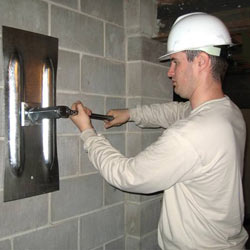 installing a wall anchor to repair an bowing foundation wall in La Porte